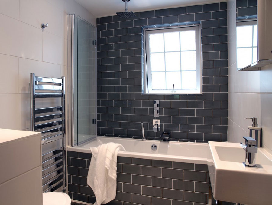 house bathroom with black brick tiles