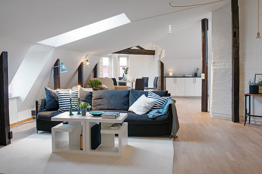 living_room_in_loft_apartment_with_scandinavian_interior_design_900x600