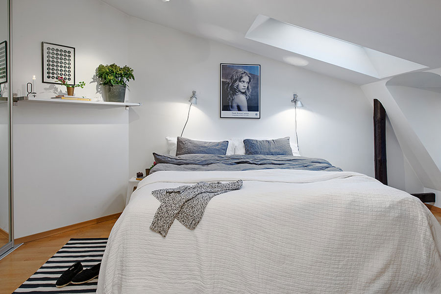loft apartment in scandinavian style with white bedroom