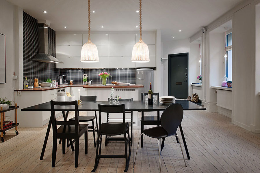 open floor kitchen scandinavian style with black tiles
