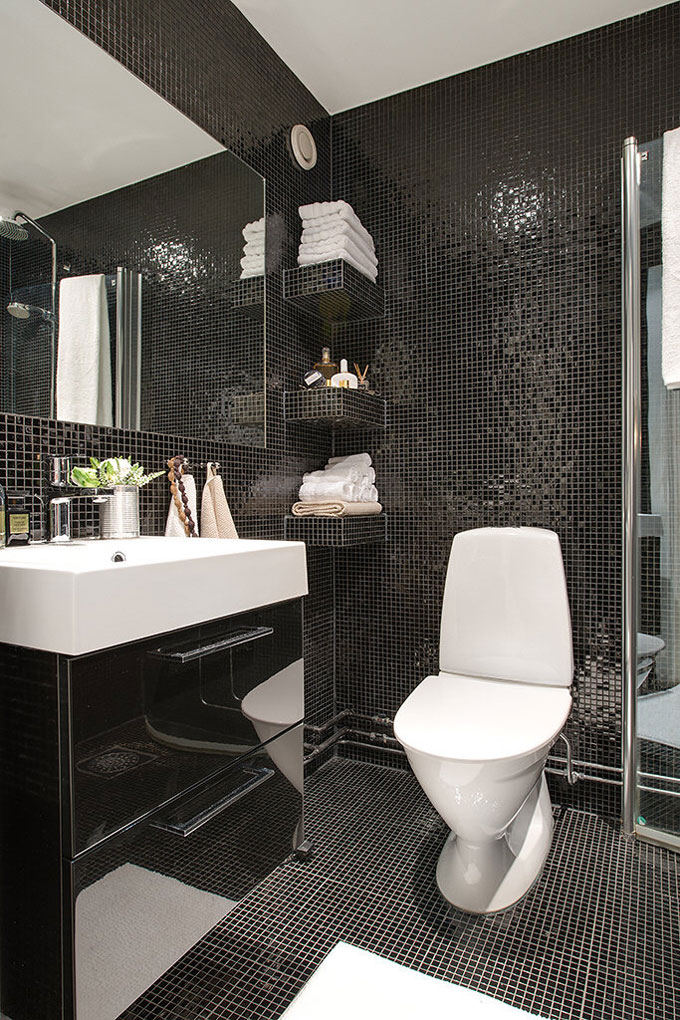 scandinavian bathroom with black tiles