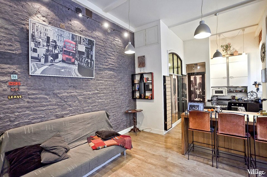 small one-room apartment with brick walls