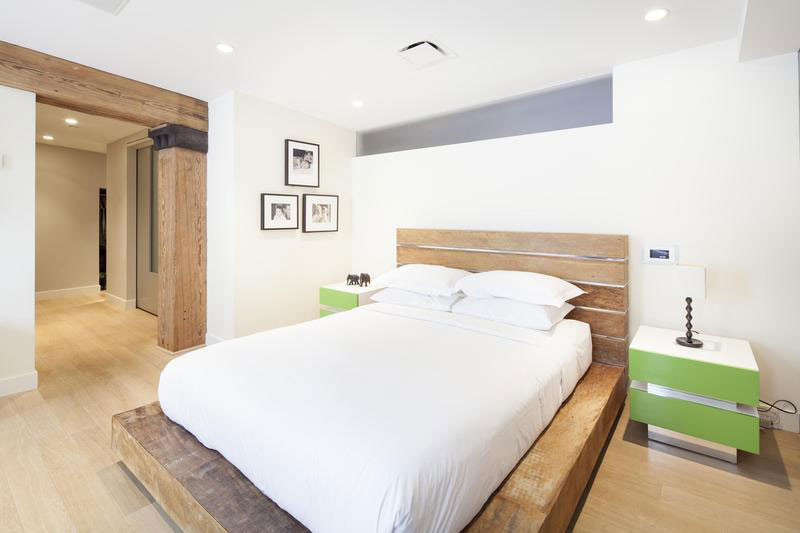 urban style bedroom with wood and brick