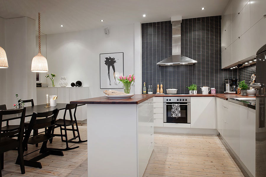 white kitchen black tiles apartment scandinavian style