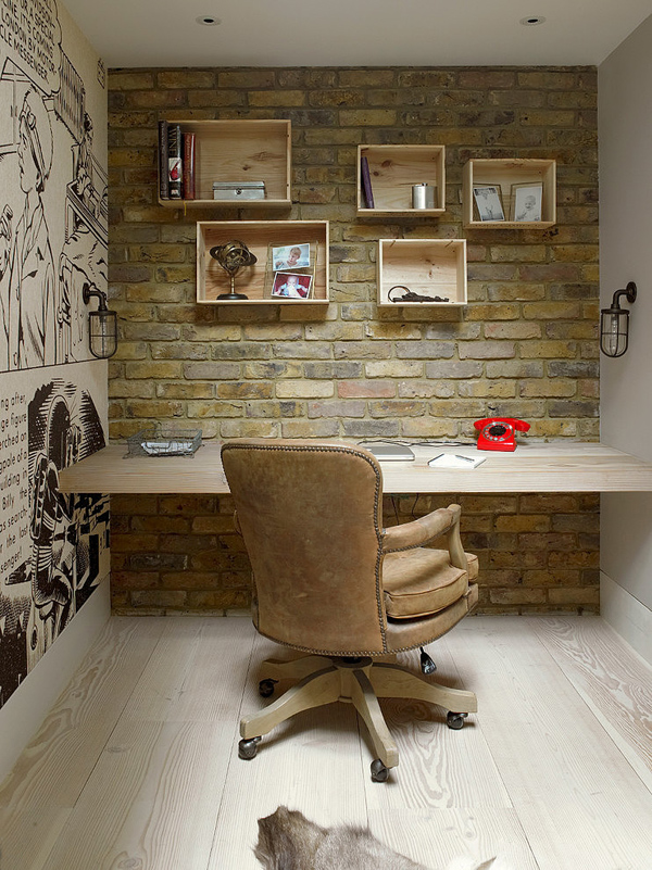 eclectic home work space with brick wall
