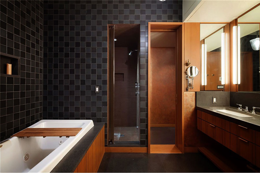 loft style apartment bathroom with dark tiles