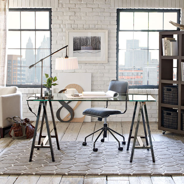 home office with white brick wall