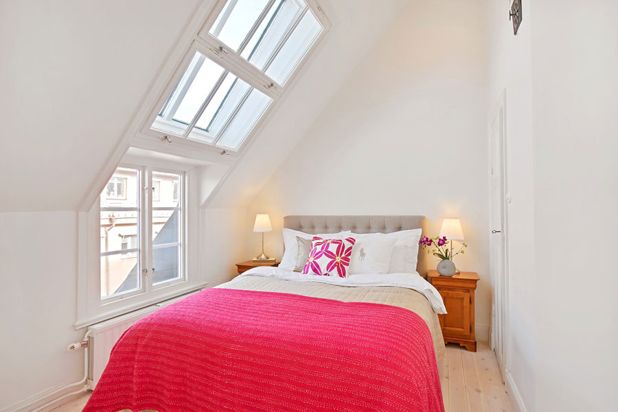 loft bedroom in white with pink accents