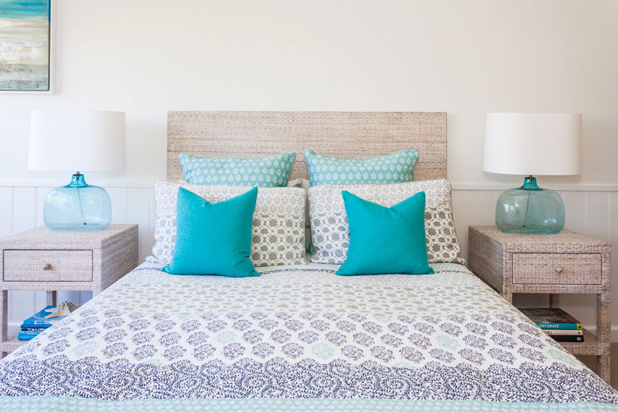master bedroom in white with turquoise accents