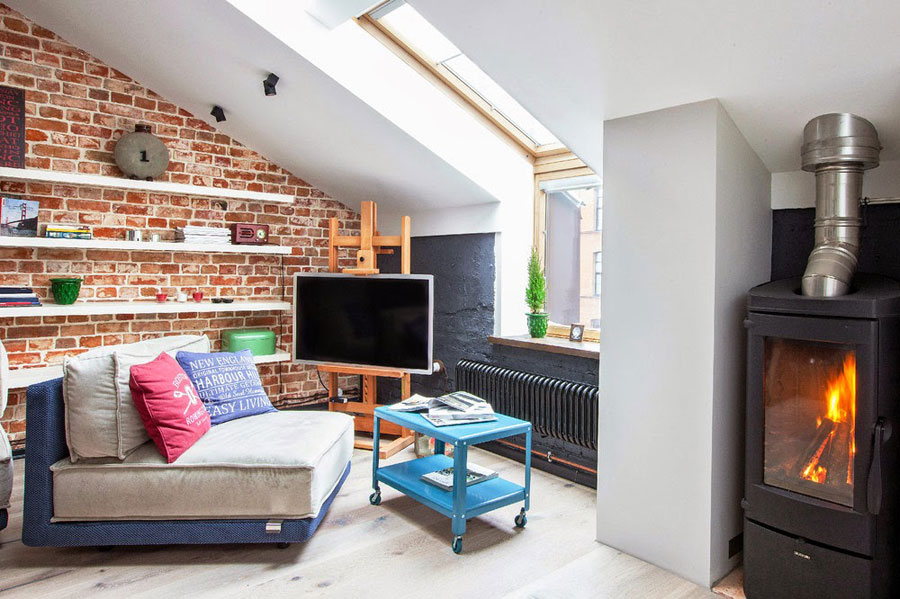 open-plan loft design with red brick walls