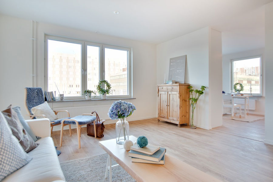 scandinavian style apartment interior design in white with birch accents