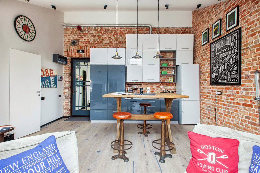 small loft white kitchen with brick walls