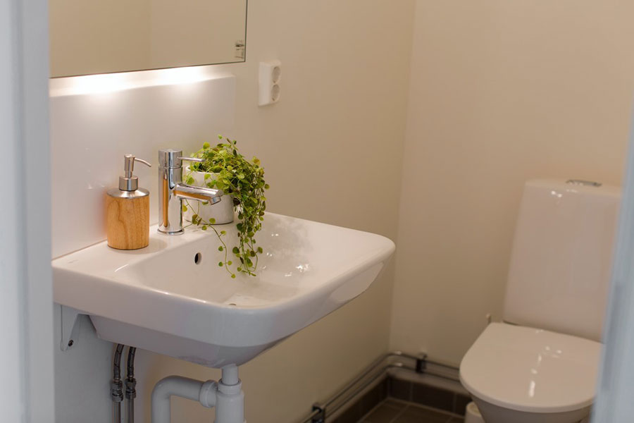 small white toilet for apartment in scandinavian style