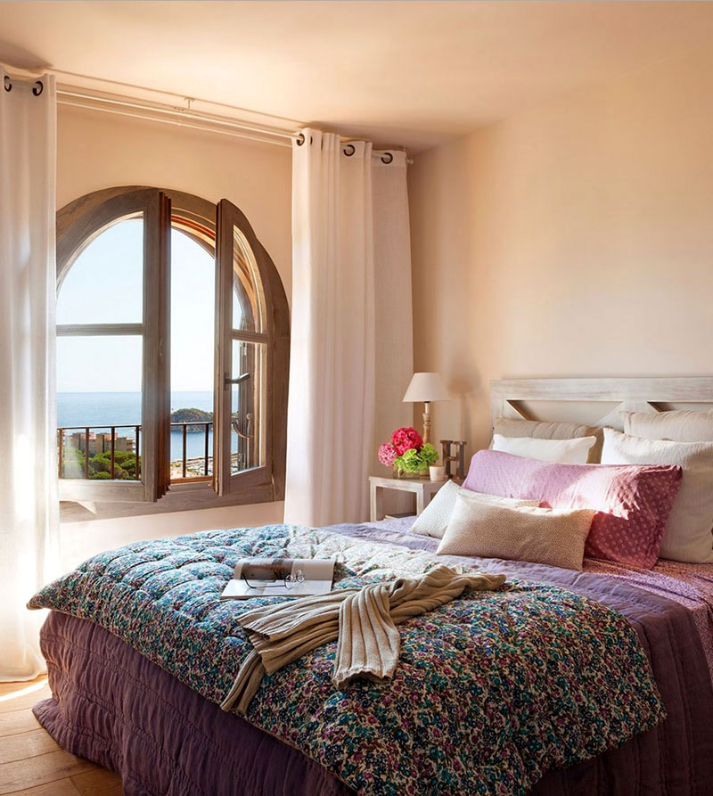 Warm and cozy spanish interior with beautiful outside view for Spanish style bedroom