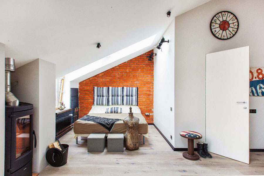 white loft interior with red brick walls