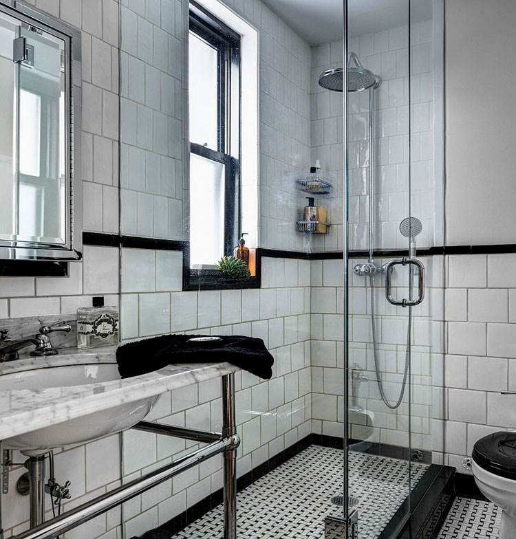 apartment bathroom design with white tiles
