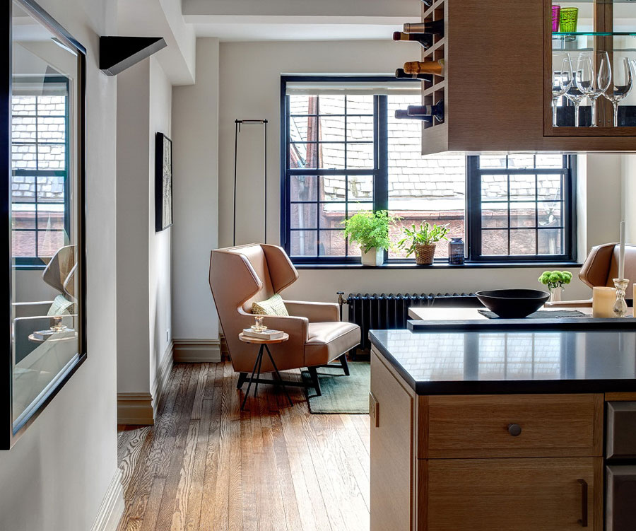 apartment interior design by lively accents of green blue orange golden shades