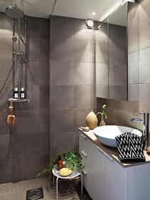 bathroom design with brown wall tiles