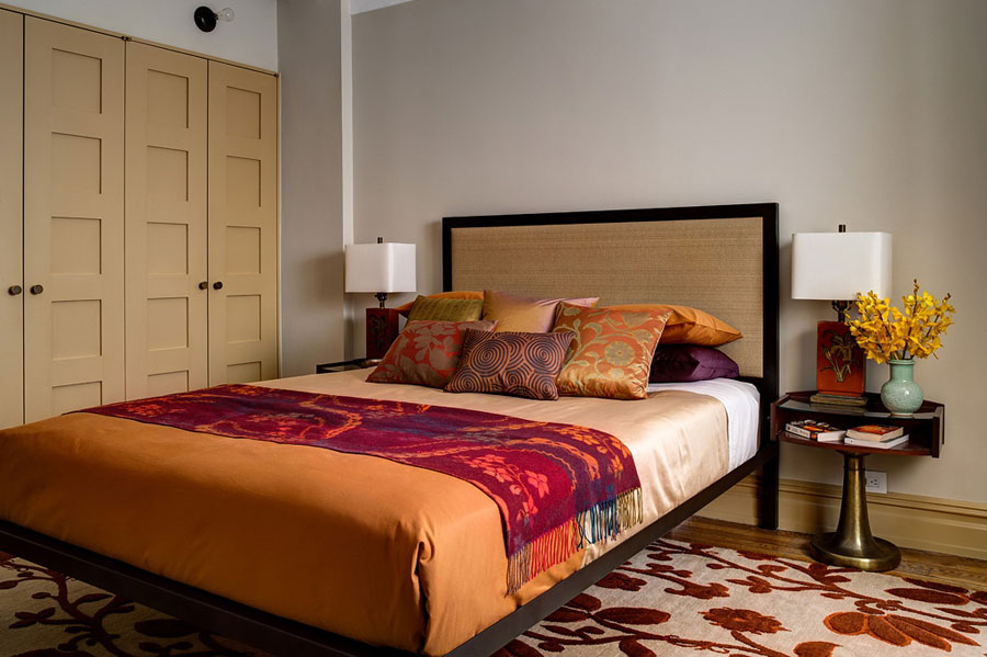 harmonious bedroom design with orange gold shades