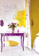 purple color desk with yellow wall accent