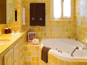 sunny bathroom design with yellow tiles