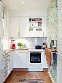 super small white kitchen design with fold down table