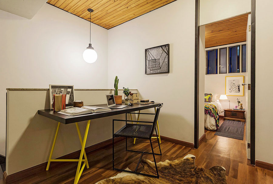 small loft apartment with bold yellow accents in savassi brazil