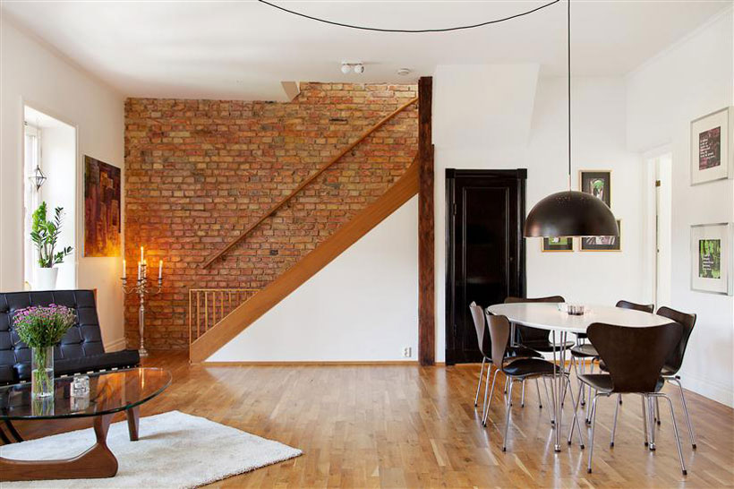 loft apartment with brick wall interior in Sweden