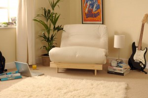 classic futon with wooden frame and tufted mattress